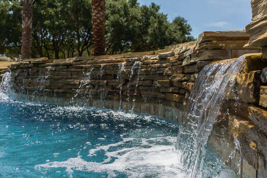 Enjoy the Sounds of the Waterfall That Also Flows Over from the Hot Tub