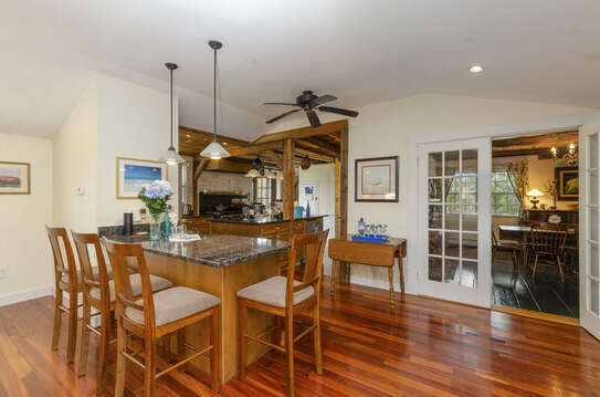 Breakfast bar opens to both kitchen and dining-60 Sisson Road Harwich Port Cape Cod New England Vacation Rentals