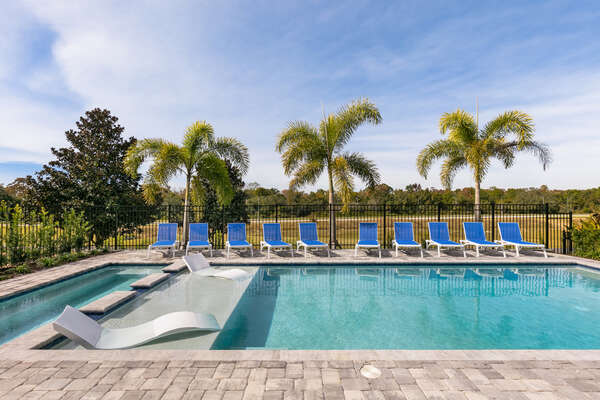 10 sun loungers surround the pool