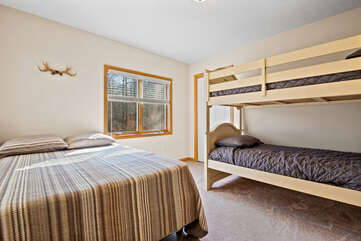 Bedroom with A Bed and a Bunk Bed