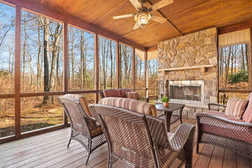 Room with Deck Seating, Ceiling Fan, and Fire Place