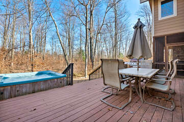 Deck with Outdoor Seating and a Hot Tub