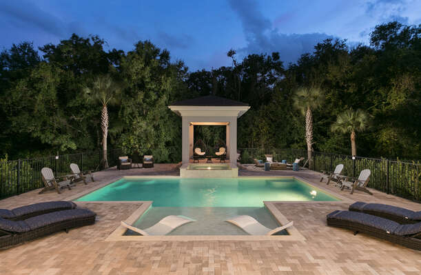 The exterior pool lighting create a wonderful atmosphere for a night-time swim