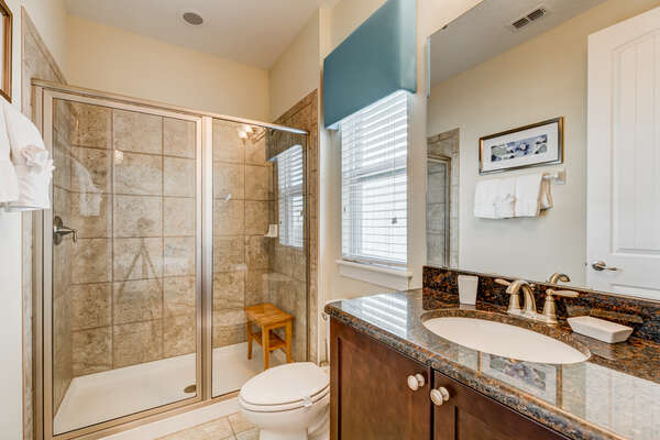 Get ready for the day in the ensuite bathroom