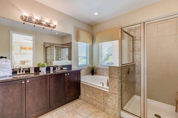 The ensuite bathroom features a walk in shower and a garden tub