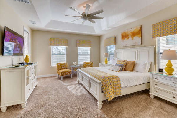 The upstairs master suite has a king bed and a sitting area