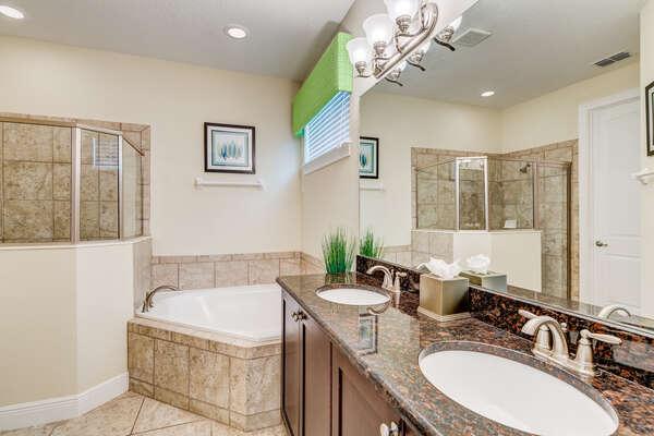 Ensuite bathroom has a dual vanity and a garden tub