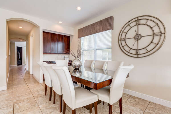 The formal dining table seats up to 6 guests