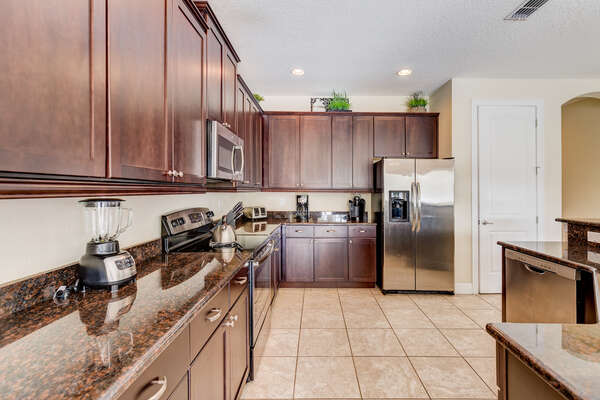 Prepare delicious meals in the fully equipped kitchen with stainless steel appliances
