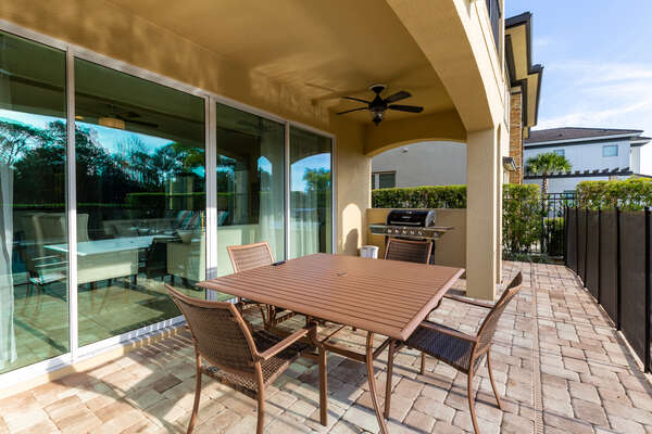 Dine alfresco at the outdoor dining table