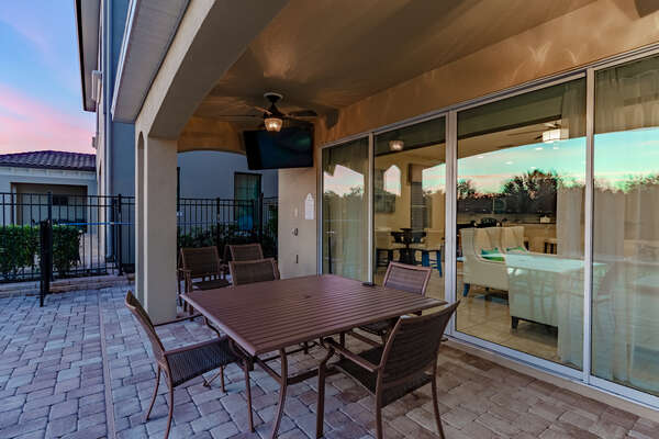 Have after-dinner drinks outside with exterior lighting and ceiling fans