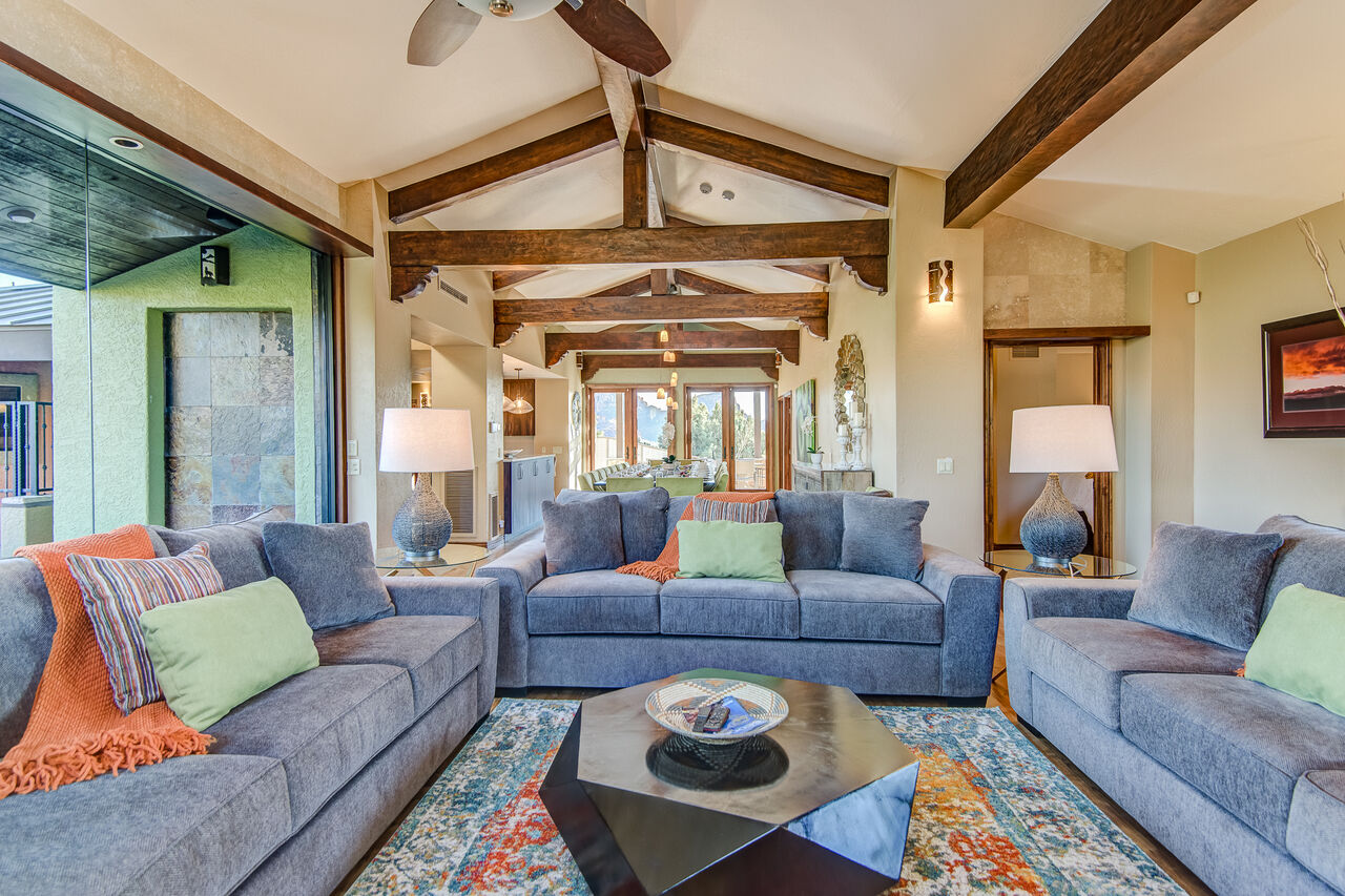 Main Level Living Room with Vaulted Wood Beam Ceilings