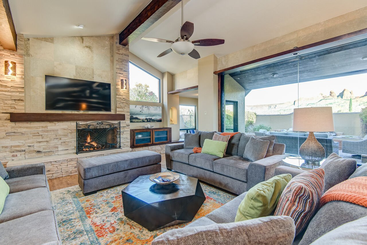 Plenty of Natural Light and Stunning Red Rock Views from the Many Doors and Windows
