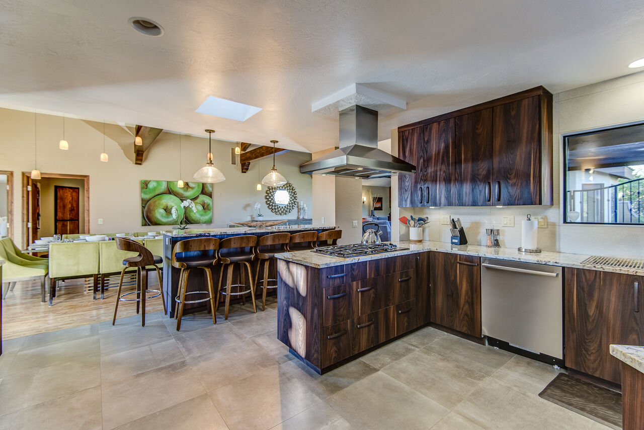Expansive and Fully Equipped Kitchen with Island Seating
