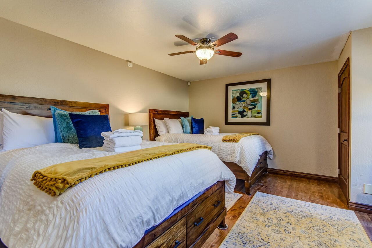 Main Level Bedroom 3 with Two Queen Beds and a 49