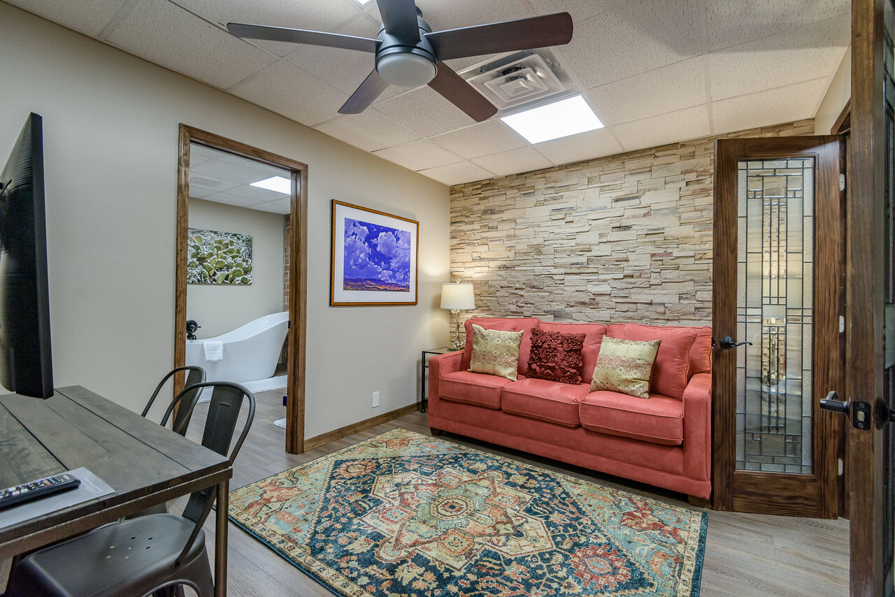 Lower Level Den with a Queen Sleeper Sofa, Desk and Smart TV