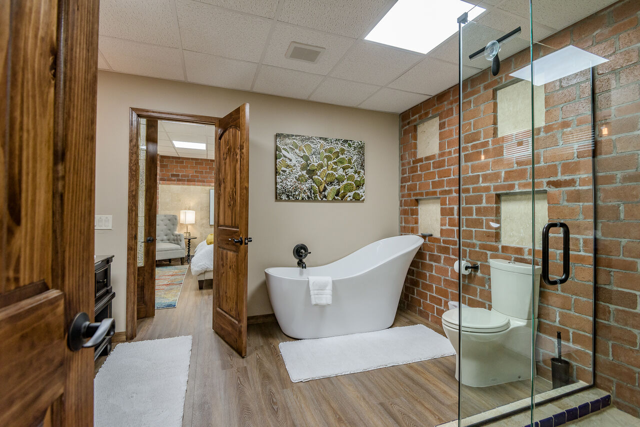 Full Shared Bath 4 with a Soaking Tub and Tile / Glass Shower