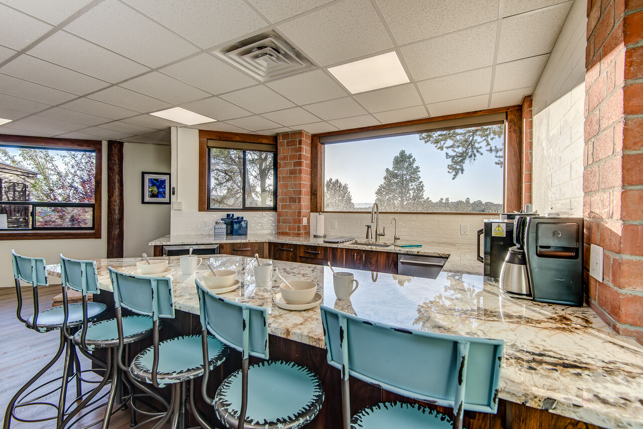 Well Equipped Wet Bar with Small Appliances and Bar Seating
