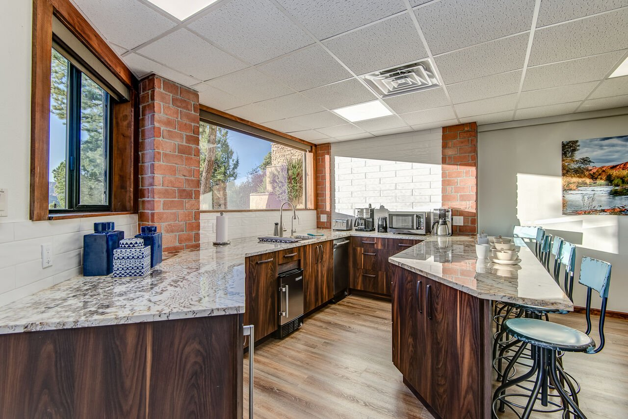 Wet Bar with Coffee Maker, Microwave, Dishwasher, Ice Maker and Wine Fridge