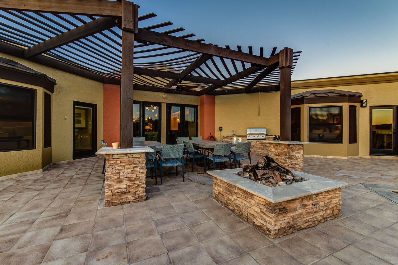 Large Back Patio with Two Large Picnic Tables and a Fire Pit