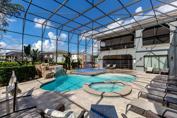The patio has a spillover spa, pool, waterfall, and splash pad