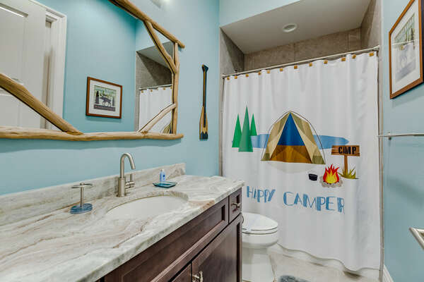 Themed bathroom with a shower and tub combo