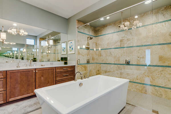 Featuring a garden tub and a walk in His and Her shower