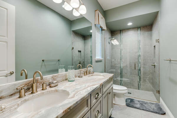The ensuite bathroom has a walk-in shower