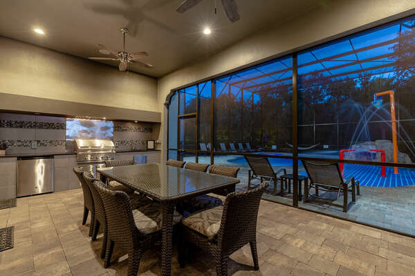 Have dinner under the stars  in the lit screened-in summer kitchen