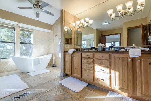 Large En Suite Bath Offering a Soaking Tub