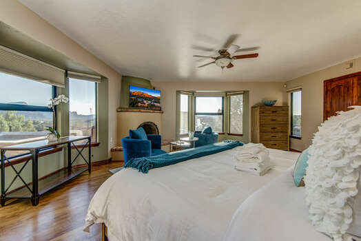 Grand Master Bedroom with a King Bed and Plenty of Windows for Natural Light and Red Rock Views