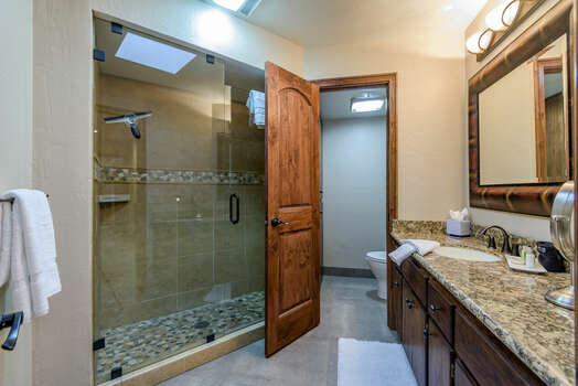 Full Shared Bath 2 with a Stone Counter Sink and Tile / Glass Shower