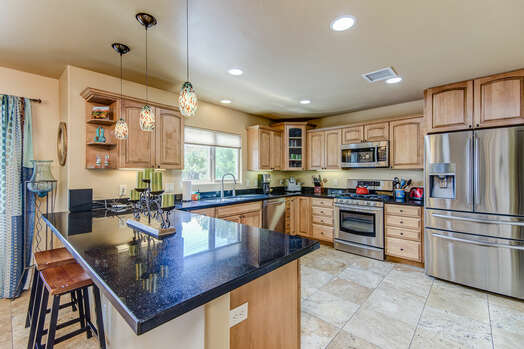 Spacious Kitchen with Granite Counters and Stainless Steel Appliances