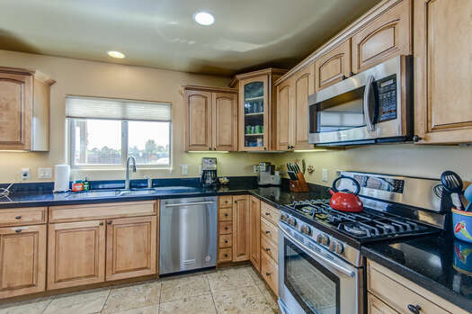 Fully Equipped Gourmet Kitchen Adorned with Travertine Tile