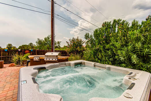 Expansive Back Patio with a Private 6-Seat Hot Tub, BBQ, Gas Fireplace, Sofa and TV