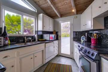 Kitchen has many windows that let the natural light into the home.