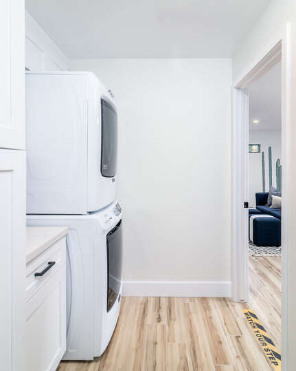 Laundry Room with stacking washer dryer unit