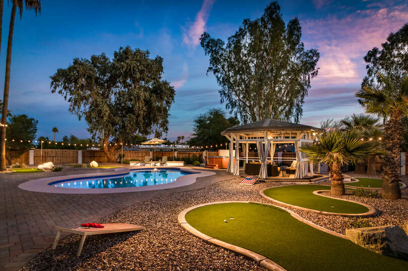 Backyard with Pool, Gazebo, and Putting Greens