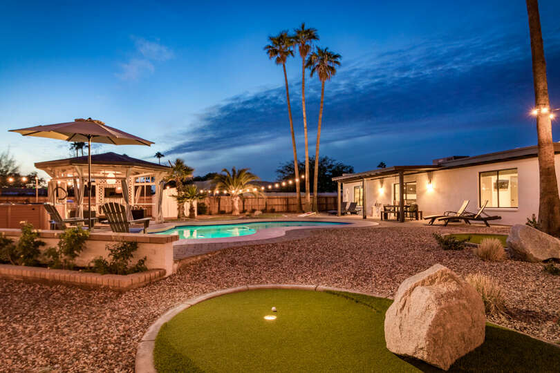 Backyard with Pool and Putting Greens
