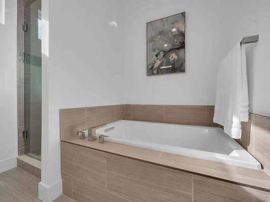 The ensuite bathroom has a large garden tub.