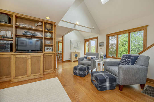 2 over sized chairs with ottomans and flat screen TV. 350 Barn Hill Road Chatham Cape Cod - New England Vacation Rentals