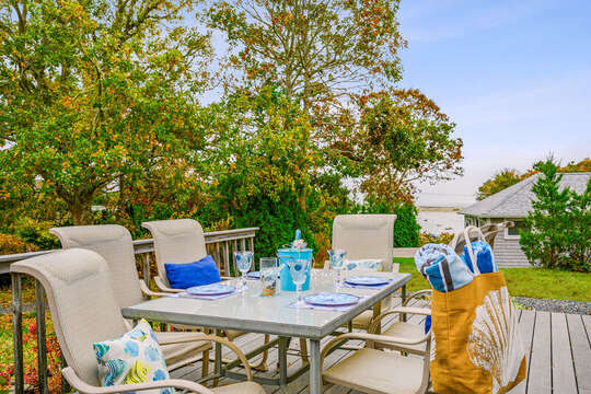 Welcome to Harborview!  Outdoor seating with a view of Oyster River. 350 Barn Hill Road Chatham Cape Cod - New England Vacation Rentals