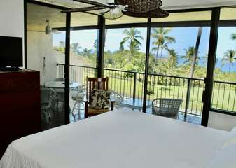 Ocean View Bedroom with White Bed and Lanai Access at Kona Country Club Villa