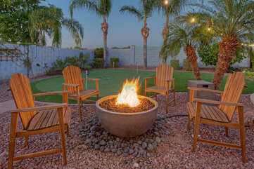 Imagine yourself toasting the good life in front of warm propane fire pit