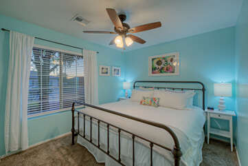 Third bedroom has a king bed and ceiling fan