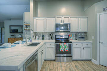 Kitchen upgrades include composite counter tops, stainless steel appliances and new floor