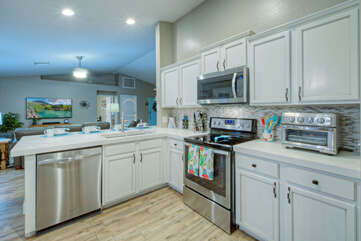 Remodeled kitchen opens into the great room so all are included in the fun