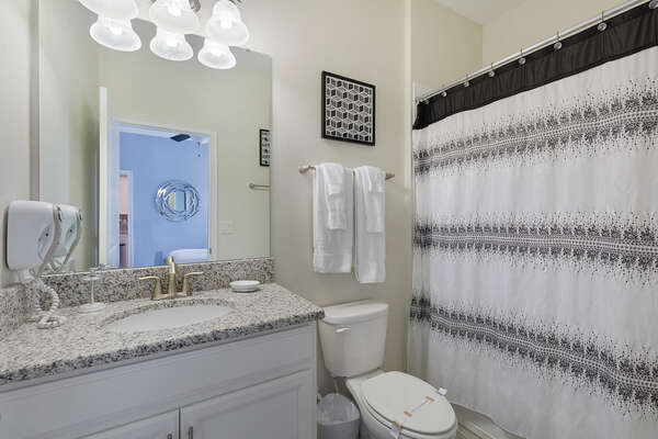 The ensuite bathroom with a shower/tub combination