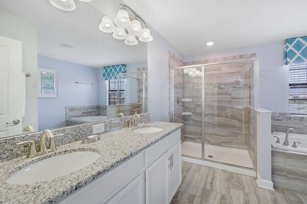 The beautiful ensuite bathroom has plenty of room for getting ready in the morning