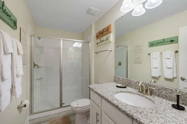 The ensuite bathroom with a walk in shower